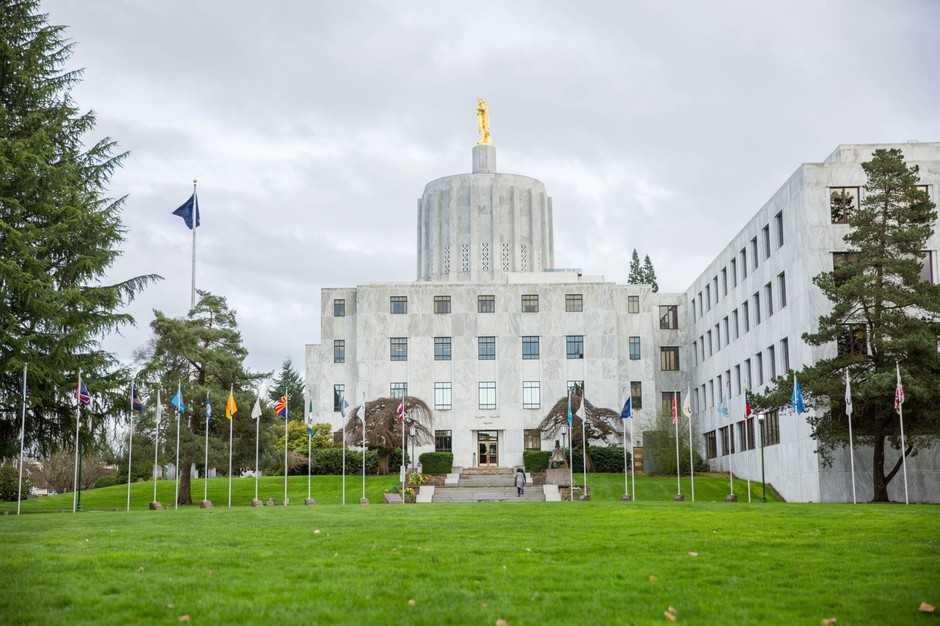 """The Oregon Capitol sits behind the """"Walk of Flags"""" in Salem, Oregon, Saturday, March 18, 2017."""
