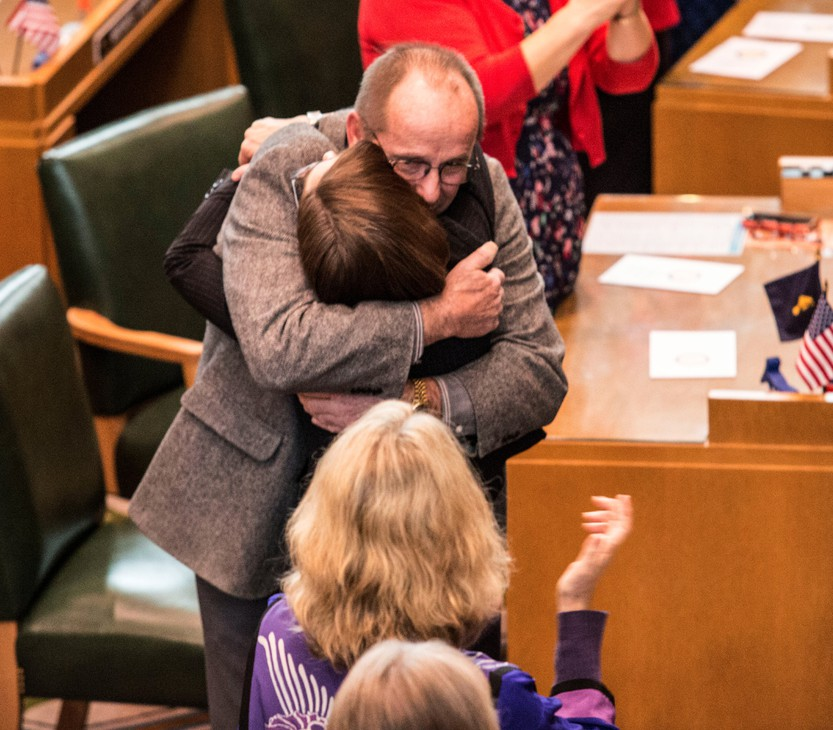 Kate Brown hugs Jeff Kruse after Brown was sworn in as Oregon's new governor.