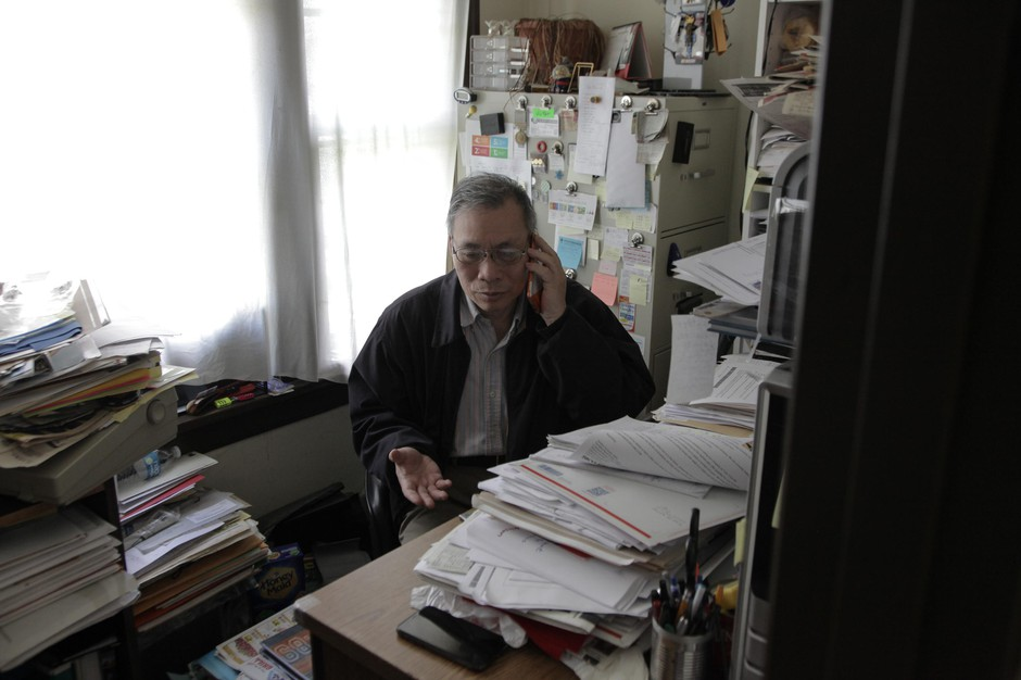 Social worker Victor Leo takes a call at his office in SE Portland on May 15, 2020. He's been translating the state's English-language unemployment forms for worried clients.
