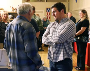 Alek Skarlatos, right, speaks with former Douglas County Commissioner Mike Winters at the Douglas County Republican Party headquarters Tuesday. Earlier in the evening, Skarlatos announced his intent to run for the Douglas County Commissioner seat recently vacated by Gary Leif.