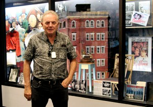"""I wanted the right people to take over Movie Madness and keep it the way I started it,"" says owner Mike Clark, standing in front of one of his favorite items, the chair Ingrid Bergman sat in in ""Casablanca,"" along with a building model used in ""Ghostbusters"" and ""Blade Runner"" and other memorabilia. ""I will live on because the store is who I am."""