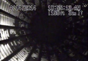 A video of a water well inspection shows black globs of oil moving through the water on NW Natural's Gasco site.